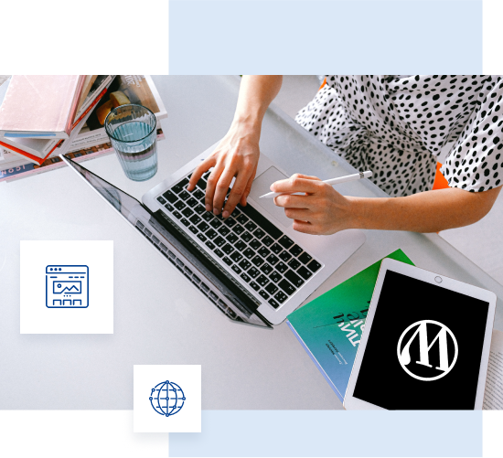 Picture showing a woman's hands placed on a computer keyboard and next to it a tablet with a Wordpress logo on the desktop.